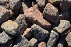 Ein Steinbeschaffenheitshintergrund Stockfotos