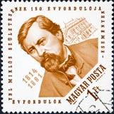 Ein Stempel, der in Ungarn gedruckt wird, zeigt Architekten Miklos Ybl und Budapest-Oper Lizenzfreie Stockfotografie
