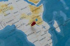 Ein Stift vom Kongo in der Weltkarte stockbilder