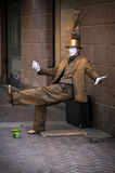 Ein Straßen-Ausführender als goldene Statue Stockfotos