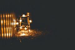 Ein Stuhl mit Lichtern Lizenzfreies Stockfoto