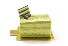 Ein Teil der Torte des grünen Tees Lizenzfreie Stockbilder