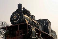 Ein Teil einer Retro- Dampflokomotive der schwarzen Farbe Lizenzfreie Stockbilder