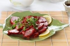 Ein Teller des chinesischen Schweinebratens Stockbild