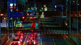 Ein timelapse der Stra?e am Stadtzentrum in Tokyo an der mittleren geschossenen Neigung der Nachtlangen Belichtung stock footage