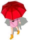 Ein topview einer Frau, die Regenschirm verwendet Lizenzfreie Stockfotos