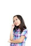Ein träumendes schönes kleines Mädchen Lizenzfreies Stockbild