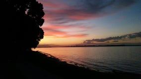 Ein Ufergegendsonnenuntergang Lizenzfreie Stockfotos