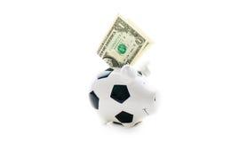 Ein US-Dollar in Piggybank auf weißem Hintergrund dollar Stockfotografie