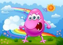 Ein verärgertes Monster mit einem Regenbogen im Himmel Stockbild
