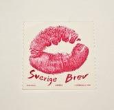 Ein verlockender Kuss auf einem schwedischen Stempel stockbilder