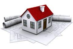 Ein weißes Haus auf den Gebäudezeichnungen Lizenzfreie Stockfotos