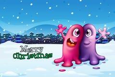 Ein Weihnachtskartendesign mit zwei Monstern Lizenzfreies Stockfoto