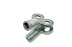 Ein Weinlese-Eisen-Quadrat-Schlüssel-Schlüssel-Werkzeug-Lügen Stockfotografie