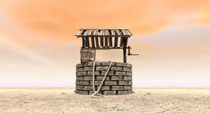 Gut wünschen mit hölzernem Eimer auf einer unfruchtbaren Landschaft Stockfoto
