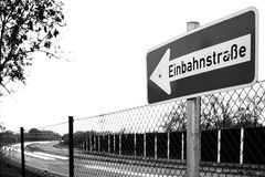 Black and white sign in front of german autobahn stock photos