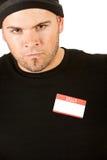 Einbrecher: Mann mit Nametag Stockfoto