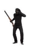 Einbrecher mit dem Gewehr, das durch ein eingebildetes Glas schaut Lizenzfreie Stockfotografie