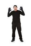Einbrecher: Räuber mit den Händen oben Lizenzfreie Stockfotos