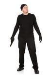 Einbrecher: Stellung mit einem Gewehr Lizenzfreie Stockfotografie