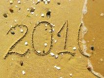 Eind van 2010 op het strand Stock Foto