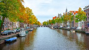 Free Eindhoven, Netherlands - 14.10.2019: Cityscape Of Amsterdam In Colorful Autumn, View To Canal With Boats, Old Colored Houses Stock Images - 165458444