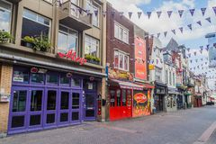 EINDHOVEN, NETHERLANDS - AUGUST 29, 2016: Buildings by a pedestrian street in the center of Eindhoven, Netherland. S royalty free stock photos