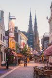 EINDHOVEN, NETHERLANDS - AUGUST 29, 2016: Pedestrian street in the center of Eindhoven, Netherlands. Saint Catherina. Church in the background stock image