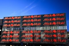 EINDHOVEN, NETHERLANDS - FEBRUARY 16. 2019: Facade of Media Markt with red letters against blue sky royalty free stock image