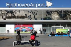 Eindhoven Airport, The Netherlands. EINDHOVEN, THE NETHERLANDS - FEBRUARY 2019: Travelers in front of Eindhoven Airport arrivals departures terminal building stock photo