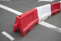 Red and white plastic barrier stock image