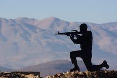 Eine Abbildung eines Schießen-Mannes Stockfotografie
