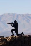 Eine Abbildung eines Schießen-Mannes Stockfoto
