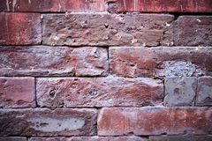 Eine alte Backsteinmauer Der Hintergrund wird von den Ziegelsteinen gemacht Muster der Struktur einer Backsteinmauer mit Maurerar Lizenzfreie Stockbilder