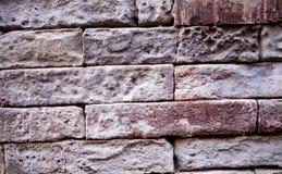 Eine alte Backsteinmauer Der Hintergrund wird von den Ziegelsteinen gemacht Muster der Struktur einer Backsteinmauer mit Maurerar Lizenzfreie Stockfotos
