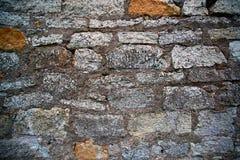 Eine alte Backsteinmauer mit Beton Stockfotografie