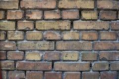 Eine alte befleckte Backsteinmauer Stockfotografie