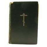 Eine alte Bibel auf einem weißen Hintergrund Lizenzfreie Stockfotos