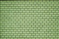 Eine alte blasse e-grün Backsteinmauerbeschaffenheit für Hintergrund Lizenzfreie Stockfotografie