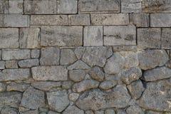 Eine alte Festungswand hergestellt von den Steinen Lizenzfreies Stockbild