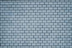 Eine alte hellblaue Backsteinmauerbeschaffenheit für Hintergrund Stockfotografie