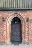Eine alte Kirche in Mitteleuropa Ein religiöses Gebäude des roten bri lizenzfreies stockbild