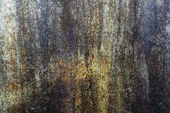 Eine alte Metallwand, rostig gelegentlich, vom Eisen lizenzfreie stockfotografie