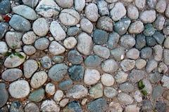 Eine alte pebblestone Straße Stockbilder