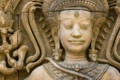 Eine alte Skulptur von einem Buddha mit einem ruhigen und ein ruhig Lizenzfreie Stockfotos
