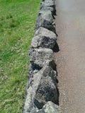 Eine alte Steingrenze Stockfotos