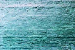 Eine alte und abgenutzte blaue Backsteinmauer Lizenzfreie Stockfotografie