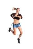 Eine attraktive Frau in einem Sprung Lizenzfreie Stockfotos