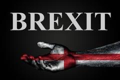 Eine ausgestreckte Hand mit einer gemalten Flagge von England und Wort BREXIT, ein Hilfszeichen oder -antrag, Unterst?tzung oder  lizenzfreie stockfotos