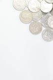 Eine Bahtmünze in der Gruppe auf oberem Recht des Rahmens Lizenzfreie Stockfotografie